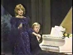 """Beverly Sills Farewell Performance. Sills highlights her career and sings a tearful final encore of the Portuguese Folk Song: """"Tell Me Why"""" that Estelle Liebling, her only voice teacher, gave her when she was ten. As a tribute to Liebling, Sills ended every recital with this song. Her long-time accompanist, Charles Wadsworth, plays for this final, moving performance."""