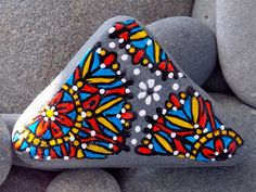 Sacred Triangle. Painted Sea Stone from Cape Cod.  Circular patterns on a triangular sea stone.  Layers of water-resistant glaze inks over paint,