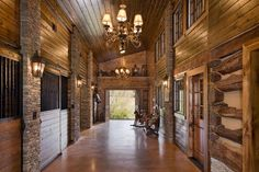 Horse stalls on the left and main living area on the right. Photo by Roger Wade