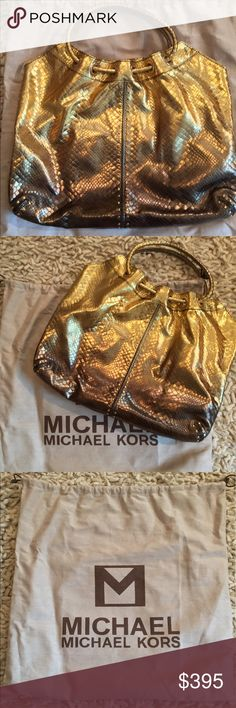 NWT Michael Kors Gold Astor Tote Lg Gorgeous and absolutely stunning! This popular MICHAEL KORS Astor comes in a beautiful Gold fading to Metallic Leather with Gold Hardware Stud detail, unique and distinguished design makes this bag a standout! A great size that fits everything you'll need!  MK dust bag included.  - Beautiful Gold Metallic Leather Exterior - Shiny Goldtone Hardware & Studded Detail - 4 Multifunction Pockets - Michael Kors Leather Tag  - Zippered Pocket - Clasp on Leather…