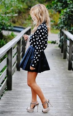 Polka dots black sleeves blouse with cute black knife pleated short skirt and light high heels ladies pumps