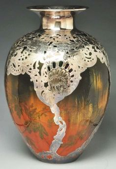 Gorgeous Rookwood vase attributed to Albert Valentine, with silver overlay by Gorham Silver Company. Made for the 1893 Chicago Columbian Exposition.
