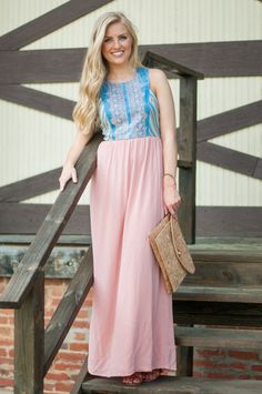 "Is it any wonder we're in a daze over here? This blushing beauty of a maxi has us stuck in a day dreams imagining all the different places we could wear it this summer! It's definitely got that ""brunch with the girls"" look we're in love with, but the beautiful colors and detail on the top deserve to be worn just about everywhere!  Blush, pink, chambray, light blue, navy, yellow, green, orange, ivory.  Material has no amount of stretch. Fully lined with hidden zipper in the back.  Lauren L…"