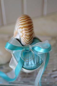 Nautilus shell ring bearer pillow for a beach wedding. Keywords: #weddings #jevelweddingplanning Follow Us: www.jevelweddingplanning.com  www.facebook.com/jevelweddingplanning/