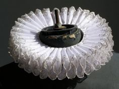 This box pleated neck ruff was a decoration of the man's neck. The one pictured would be worn by royalty or someone very wealthy, for it has intricated silver designs sewn into it. These were almost always found in white and made from a variety of materials depending on social class.