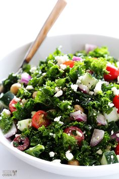 Chopped Kale Greek Salad |  Salad:1 large bunch (about 10 ounces) kale leaves, finely chopped; 1 pint cherry or grape tomatoes, halved; 1 cucumber, seeded and diced; 15 ounces chickpeas; 1/2 red onion, thinly sliced; 2/3 cup Kalamata olives; 2/3 cup crumbled feta. Vinaigrette: 1/2 cup olive oil; 1/4 cup parsley leaves, finely chopped; 3 Tbsp. lemon juice; 3 Tbsp. red wine vinegar; 2 garlic cloves finely chopped; 1 tsp. dried oregano; 1/2 tsp. sugar; 1/4 tsp. salt; 1/4 tsp. black pepper.
