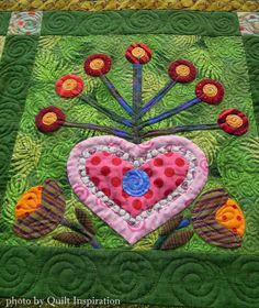 Floral Fantasy by Manya Powell, quilted by Linda Powell.  Flowerbed pattern by Sue Spargo.  Photo by Quilt Inspiration