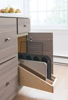 Finally, Martha also installed tray dividers, which tame cookie and baking sheets. They're stored vertically in their own drawer, making storing and selecting the perfect trays a simple task. Shop Martha Stewart Living Kitchens at The Home Depot Kitchen Island Storage, Kitchen Redo, New Kitchen, Kitchen Remodel, Kitchen Design, 1920s Kitchen, Home Depot Kitchen, Kitchen Small, Kitchen Ideas
