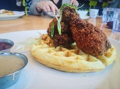 Move aside bacon and eggs it's time for spiced fried chicken and Belgium waffles topped with maple honey hot sauce and white chicken gravy