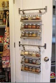Spices organized on the back of the pantry door :: OrganizingMadeFun.com