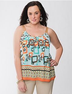 Boasting the flirty femininity you love about our exclusive Lane Collection, this gorgeous woven tank is a must for the sunny days ahead. Double-layered woven tank brightens your outlook with unique mixed prints, charming grosgrain ribbon straps and a scoop neckline with buttoned keyhole detail. Versatile style dresses up for the office or down for weekend fun. lanebryant.com