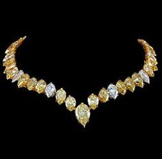 GRADUATED PEAR SHAPE DIAMOND NECKLACE - 66.05 Carat Fancy Intense Yellow and White diamond graduated Pear Shape necklace, 70 stones total.