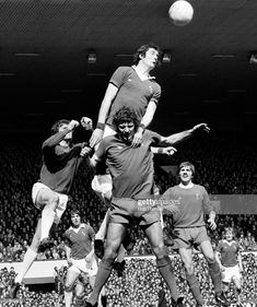 Mick Lyons of Everton jumps high above Liverpool striker John Toshack to head the ball during the Division One match against Liverpool played at Anfield, Liverpool on April Liverpool won Merseyside Derby, 3rd April, High Jump, Everton, Division, Liverpool, Football, Goals, Club