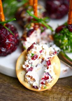 Holiday entertaining has never been easier or more delicious with these Cranberry Pecan Mini Goat Cheese Balls! So easy to make and gorgeous too! Perfect for Thanksgiving, Christmas, and New Year's! (Can be made in advance!) // Mom On Timeout