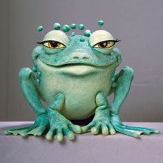PuppetHeap A small hand puppet frog, Nina, is featured in Ms. Chang's stage show, The Magical World of Grace Chang.