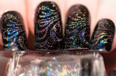 Hologram glitter on black. Great with spring 2013 prismatic styles.