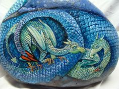 Blue Winged Dragon with Baby Dragons, Hand Painted Rock,Fine Art, Extra Large stone. This is a 45 pound hand painted rock with Dragon and her babies.