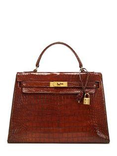 & what an accessory! Vintage Hermès brown glazed crocodile Kelly bag. via gilt