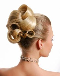 Starlet loves this pretty updo.  Try a classic look with barrel curls for a clean sleek, elegant look from 1950's.
