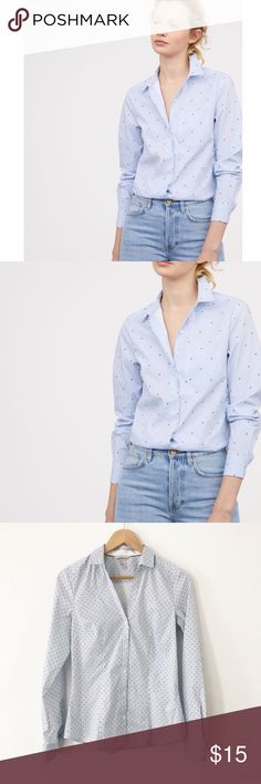 """H&M • Fitted Stripe Polka Dot Button Down Fitted button down shirt. Great condition except there's a mark on the tag/collar. Buttons at the wrist. Collared. Sleeve length is 19"""", pit to bottom at shortest part is 14.5"""". H&M sizing runs small!! Tag says 6 but fits smaller. Cover photo is very similar but not exact!! There are many more dots on the actual shirt, and it is a solid blue. NO POCKET on actual shirt H&M Tops Button Down Shirts"""