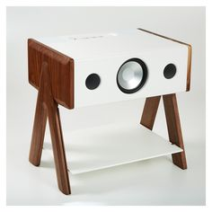 <p>Enhance the ambience of your home with the crisp sounds of the exclusive La Boîte Concept Cube Speaker in a Corian walnut finish.</p>