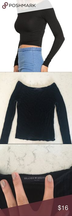 Brandy Melville Black Long Sleeve Top Super fitted and soft long sleeve from Brandy! Very cozy and incredibly flattering. Slightly cropped, but not enough to be considered a crop top. Has slightly wide shoulders (as seen in picture). In perfect condition! Brandy Melville Tops Tees - Long Sleeve