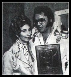Elvis is presented with a plaque for the 1975 charity concert in Jackson, Mississippi, which benefited victims of the McComb, Mississippi, tornado..