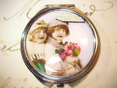 Compact Mirror with Vintage Friends by RubysRibbonsandBows on Etsy.