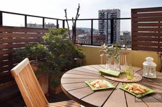 Attic apartment with terrace and decorated to create a cozy and relaxing atmosphere, perfect for accommodating up to a maximum of 4 guests. Details: http://www.gowithoh.com/vacation-barcelona-apartments/ref_15723/?sm&utm_source=pinterest&utm_medium=socialmedia&utm_campaign=product #GowithOh #Barcelona
