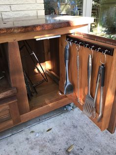 There's plenty of storage space inside the MORGAN design Big Green Egg Table by www.PoshPatios.com