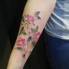 Watercolor flower tattoo on the right inner forearm, inspired by the work of Margaret Mee.