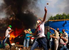 Egyptian protesters throw rocks at security forces during the clearing of one of the two sit-ins of president Morsi supporters, at Rabaa Adawiya mosque, Cairo, Egypt, August 14, 2013. #R4BIA