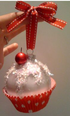 Make your own Cupcake Ornament. Dollar store bulb, cupcake paper, some glitter and ribbon. Freaking CUTE!