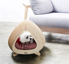 The BBung-a House from Korean design studio POTE, is a modern plywood pet hideout whose unique shape is inspired by the structure of fishbones.
