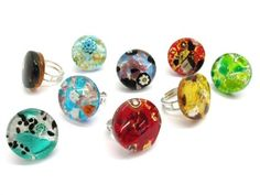Murano Glass round Rings, 25 mm in diameter ( ) available in 11 different colours, made entirely handmade by Murano master glass-makers with the glass sheet technique, and silver 925 and gold 24 kt insertions, adjustable band in allergy-free metal. Glass Jewelry, Pendant Jewelry, Jewelry Necklaces, Glass Ring, Jewellery, Murano Glass, Wholesale Jewelry, Beautiful Rings, Different Colors