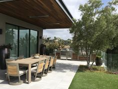 Custom outdoor kitchen and covered dining area for our Chalon project in Bel Air, California. #outdoorcooking #outdoorkitchen #kitchendesign #builtinkitchen #patio #diningspace #outdoordining #outdoorfurniture #outdoordiningarea #coveredpatio #overhang #builtinbarbecue #BBQ #landscaping #landscapearchitecture #landscapedesign #backyardcooking #belair #california #outdoorliving #outdoorspace
