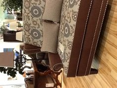 Beautiful upholstery on a loveseat. Love the houndstooth piping.