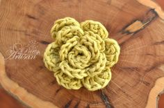 New at crochet? This cute little flower is easy enough for a beginner... and such a fun little embellishment for a hat, jacket and more. Tutorial form The Party Artisan.