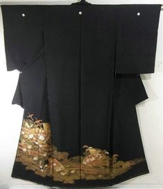 This is a kimono fabric cut into Kurotomesode shape and stitched roughly before sewing to make kurotomesode.  It has classical design such as jigami'(fan shape), clouds and flying crane, which is dyed.  It also has fine design such as 'ume'(Japanese plum), 'botan'(peony), 'matsu'(pine tree) and checker board
