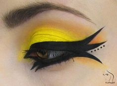 Yellow eyeshadow for the daring with very experimental liquid liner and detailed dots x