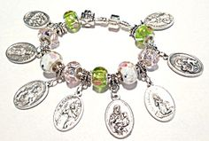 $129 Sterling silver murano glass pandora - style Catholic saints charm bracelet:   Pink, white green glass   (1) HOLY TRINITY/PRAY FOR US;   (2) HEART & CROWN OF THORNS/INFANT OF PRAGUE;   (3) SACRED HEART OF JESUS/SACRED HEART OF MARY;   (4)ST. CHRISTOPHER/PRAY FOR US;   (5) ST. ANN & CHILD VIRGIN MARY/PRAY FOR US;   (6) ST. BERNADETTE/LOURDES GROTTO;   (7) ST.JOSEPH/PRAY FOR US;   (8) HOLY FAMILY/GUARDIAN ANGEL
