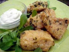 Parmesan chicken nuggets | Ingredients 2 skinless boneless chicken breast fillets ½ cup homemade breadcrumbs ¼ cup Parmesan or Grana Padano cheese, grated 1 tbs fresh parsley, chopped Pinch of salt and black pepper 1 egg, lightly beaten 2 tbs butter, melted Garlic mayonnaise dip: 1/3 cup mayonnaise 1/3 cup fromage frais (farmer's cheese) 1 garlic clove, crushed Black []