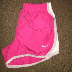 Nike Youth Shorts A pair of youth size 6 Nike dri fit shorts they are pink and white with light gray accents there is a tiny tiny pen drop on the back which you can see in the third photo!!! They are still in good condition from a smoke free house Nike Shorts