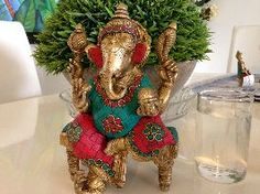 Brass Ganesha with Coral Stones on a Chowki