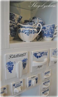 Blue and white antique ceramic drawers built into new kitchen cabinet -- Ateljé Skogslyckan
