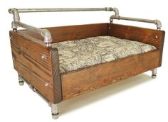 Dogamo Vanderbilt Wooden Bed Douglas fir pine tree and industrial pipes make up this beautiful dog bed. On par with the wooden and natural aesthetic of Portland, this bed features an urban yet natural finish to slip effortlessly into your home decor.