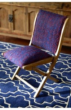 Hand upholstered in India, this elegant folding chair offer a navy sari silk embroidered design sitting atop a rustic wooden frame. Sari Silk, Discount Rugs, Rugs Usa, Indoor Outdoor Rugs, Modern Rugs, Floor Rugs, Just In Case, Upholstery, Dining Chairs