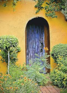 Blue door in Yellow Wall. Location, photographer unknown. Thank you tumblr. Addendum: Mesilla, New Mexico. By twbphotos