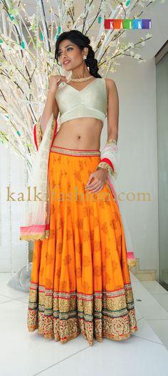 http://www.kalkifashion.com/   Model in orange and off white lehenga choli displaying Varun's Jewelry Collection
