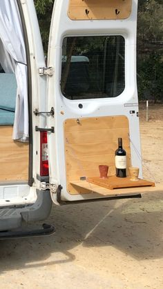 Camper van fitted with fold-down table on the inside of the door
